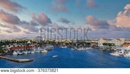 Boat And Ship Harbor On Aruba Under Nice Sky