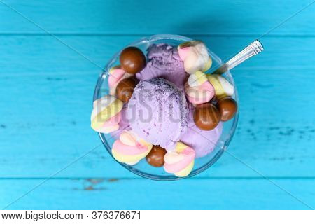 Top View Bowl Of Fresh Sweet Potato Flavor Ice Cream Sundae Mixed With Chocolate Candy And Marshmall