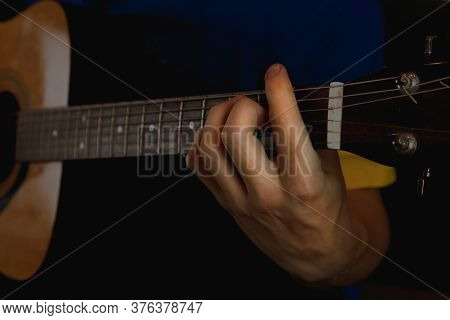 The Guitar Player Plays, Fingers On The Guitar Neck Make A Chord, Close Up.