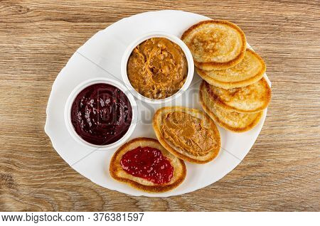 Bowls With Raspberry Jam And Peanut Butter, Pancakes With Jam And Peanut Butter In White Dish On Woo