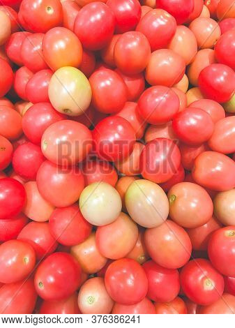 Closed Up Pile Of Thai Small Tomatoes Or Seeda Tomatoes. It's A Main Ingredient Of Papaya Salad Menu
