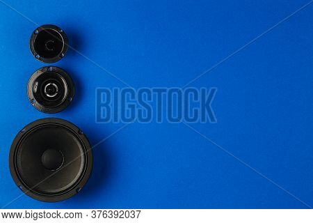 Car Audio. Car Speakers, Bass Speaker And Midrange Speaker Lie In A Row On A Blue Background. Copy S