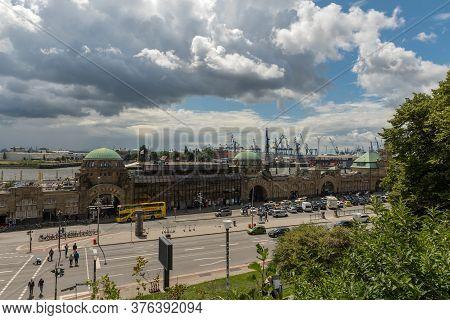 View Of The Famous Hamburg Landungsbruecken With Harbor, St. Pauli District, Hamburg, Germany