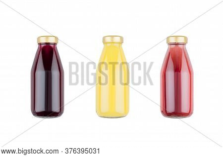 Summer Fruits Juices - Orange Juice, Strawberry, Currant In Glass Bottles  Isolated, Mock Up For Des