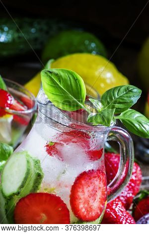 Lemonade With A Strawberry, Lemon, Cucumber And Basil, Glass Pitcher, Selective Focus