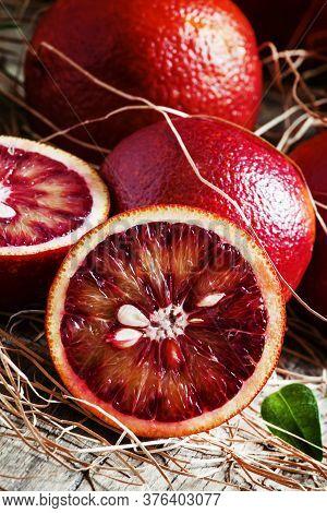 Halved Red Sicilian Oranges, Vintage Wooden Background, Selective Focus