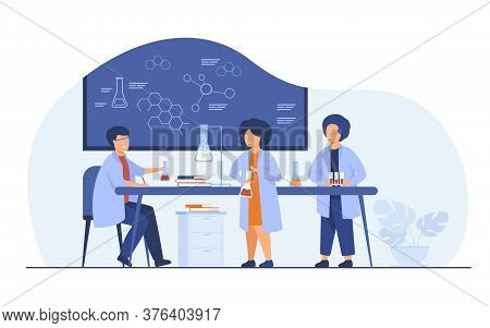 School Education And Science Concept. Teacher Watching Children Doing Practical Chemical Experiment