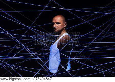 Photo Of Bald Man Tangled In White Threads In Ultraviolet