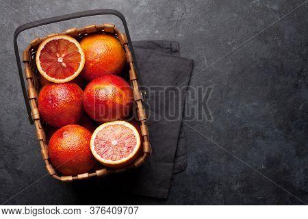 Sicilian Blood juicy oranges in basket. Top view with copy space