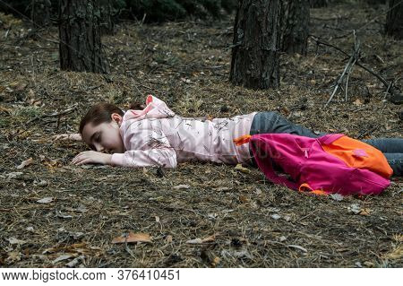 Murder In The Woods.the Body Of A Teenage Girl In A Tracksuit Lies On The Ground In The Woods. Victi