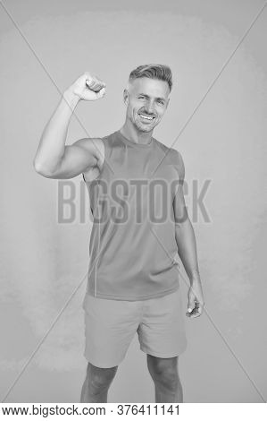 Boost Your Athletic Power. Happy Man Fix Arm Blue Background. Fit Guy Show Muscle Power. Sports Clot