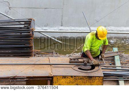 Asian Construction Worker Is Using Steel Bending Machine Bender Rebar For Casting Foundation Concret