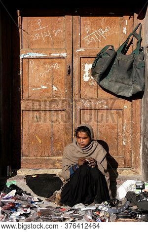 Ladakh, Leh, India - August 12, 2020 : Poor Indian Girl Selling Accessories (mobile Case, Leather Be