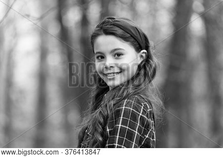 Smiling Girl Wear Knotted Headband. Biggest Hair Accessory Trends. Adorable Little Girl Checkered Sh