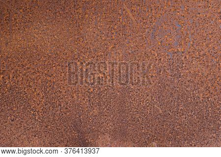 Old Rusty Corroded Aged Steel Metal Plate In Construction Site. Construction Industry And Background