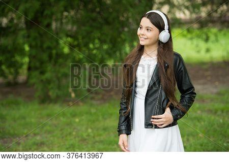 Summer Speaks Its Time To Listen. Happy Girl Listen To Music In Summer Park. New Technology. Modern