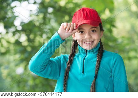 Fantastic Finishing Touch To Your Hipster Outfit. Little Girl Wear Hipster Cap Outdoors. Fashion Acc