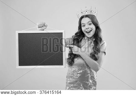 Specially For You. Happy Child In Crown Point Finger At Blackboard. Product Promotion. Product Adver