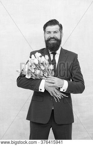 Making Surprise. Gentleman With Tulips. Spring Is Coming. Greetings. Bearded Man With Tulip Bouquet.
