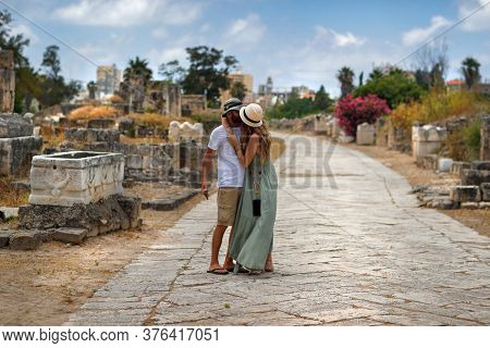 Young Happy Couple Kissing in Romantic Summer Vacation. With Pleasure Spending Honeymoon on Ruins of Tyre in Lebanon. Enjoying Life.