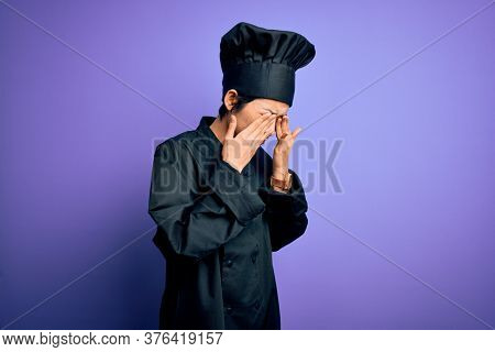 Young beautiful chinese chef woman wearing cooker uniform and hat over purple background rubbing eyes for fatigue and headache, sleepy and tired expression. Vision problem