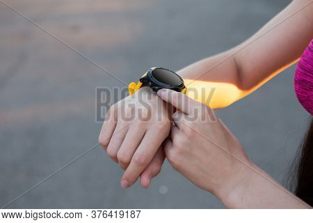 Closeup View On Hand Of Woman And Fitness Health Tracker Wearable Watch