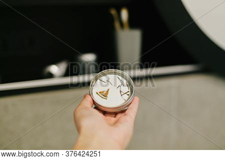 Hand Holding Eco Solid Shampoo In Metal Can In Modern Bathroom On Background Of Stylish Black Shelf