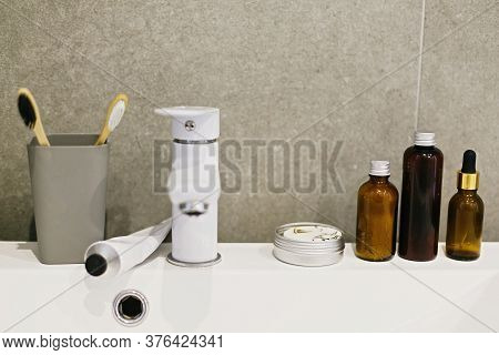Bamboo Toothbrush, Ubtan For Skin, Solid Shampoo In Metal Can, Toothpaste In Metal Tube, Tonic On Wh
