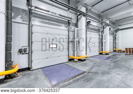 Loading Gates Of A Large Industrial Warehouse. Industrial Interior.