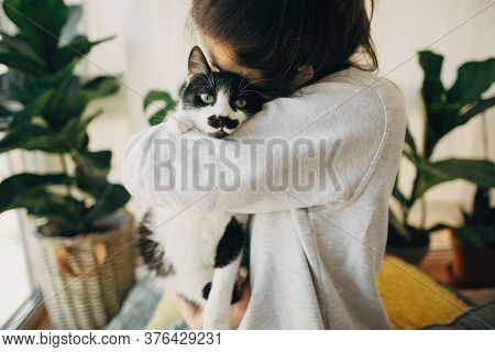 Hipster Girl Hugging Cute Cat, Sitting Together At Home During Coronavirus Quarantine. Stay Home Sta