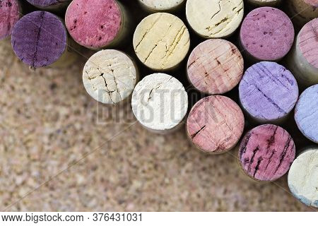 Wine Corks Close Up, Wine Dark Spots On Corks From Red Wine. Multicolored Corks Made Up In Rows Alon