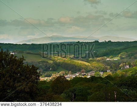 The Village of Llangeitho in the county of Ceredigion with Plynlimon/Pumlumon Fawr 752m or 2,467ft 20 miles in the distance, its the highest point in mid-Wales and the source of the rivers Wye and Severn.