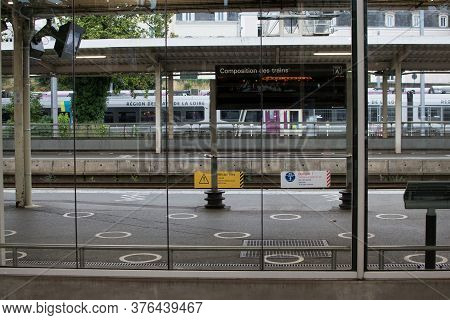 Angers, France, June 06, 2020:train Commuter People Going To Work Or Treveling Waiting For Delayed T