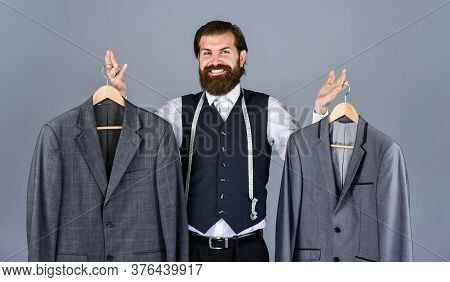 Tailor Sewing. Handsome Bearded Fashion Man In Classical Costume Suit. Man In Custom Suit Presenting