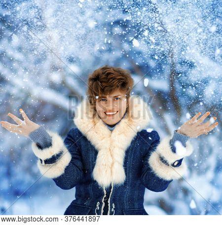 Portrait Of Joyful Winter Woman With Short Haircut In Luxury Fur Coat. Beauty Fashion Model Girl In