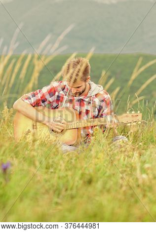 Inspiring Environment. Man Musician With Guitar On Top Mountain. Inspired Musician. Summer Music Fes