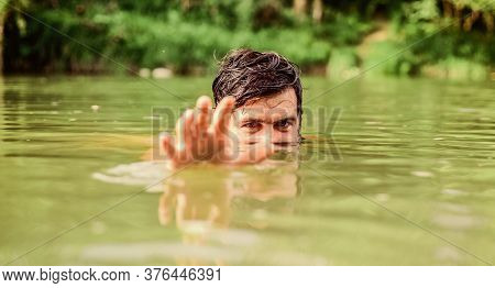 Spy On. Brutal Hipster With Wet Beard. Refreshing In River Water. Water Beast. Furry Monster. Wild M