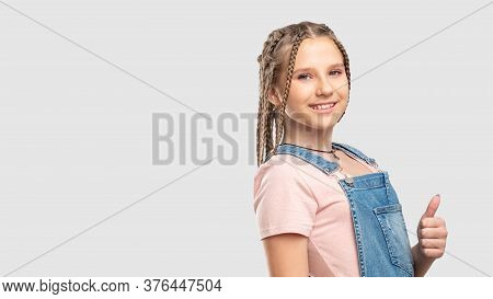Like Gesture. Perfect Choice. Cheerful Teen Girl Showing Thumb Up Smiling Isolated On Neutral Copy S