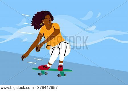 Skateboarding, Sport, Recreation, Summertime Concept. Young African American Woman Girl Teenager Ath