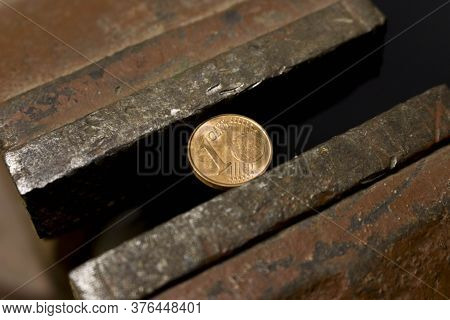 1 Euro Cent Coin In A Metal Vise. Concept Of Economic Problems. Selective Focus. Close Up