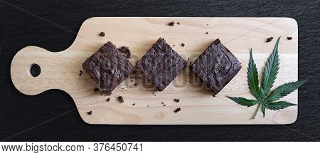 Dark Chocolate Homemade Brownies Infused With Medical Cannabis, With Marijuana Leaf