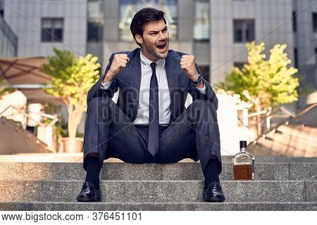 Anxious Businessman Sitting In Steps. Stressed Businessman Headache And Look Down With Depress Feeli