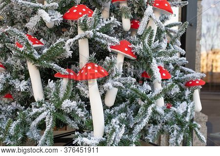 Artificial Eco Christmas Tree Decorated With Mushrooms With A Red Speckled Hat With White Snow. Deco