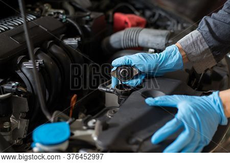 Checking The Engine, Mechanic Checking Car Radiator, Close-up.