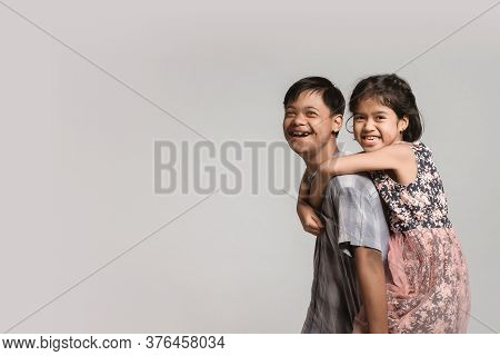 Picture Of Girl Hugging Boy. Happy Feelings, Tenderness, Care.boy With Down Syndrome.