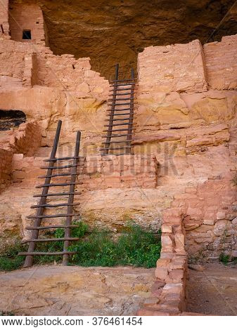 Ladders In Ancient Cliff Dwelling Built By Indigenous People Of The American Southwest. Well Over 90