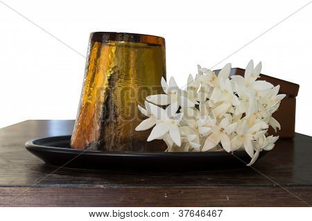 Glass and White Flowers On Table.