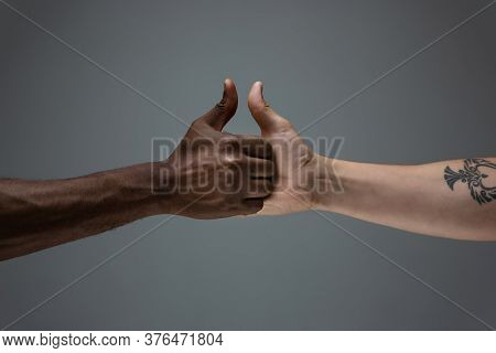 Friends Time. Racial Tolerance. Respect Social Unity. African And Caucasian Hands Gesturing On Gray