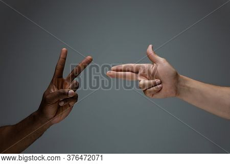 Peace And War. Racial Tolerance. Respect Social Unity. African And Caucasian Hands Gesturing On Gray