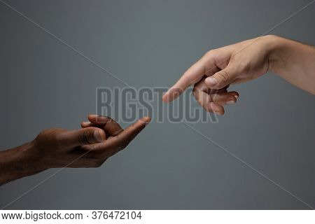 Touching Of God. Racial Tolerance. Respect Social Unity. African And Caucasian Hands Gesturing On Gr